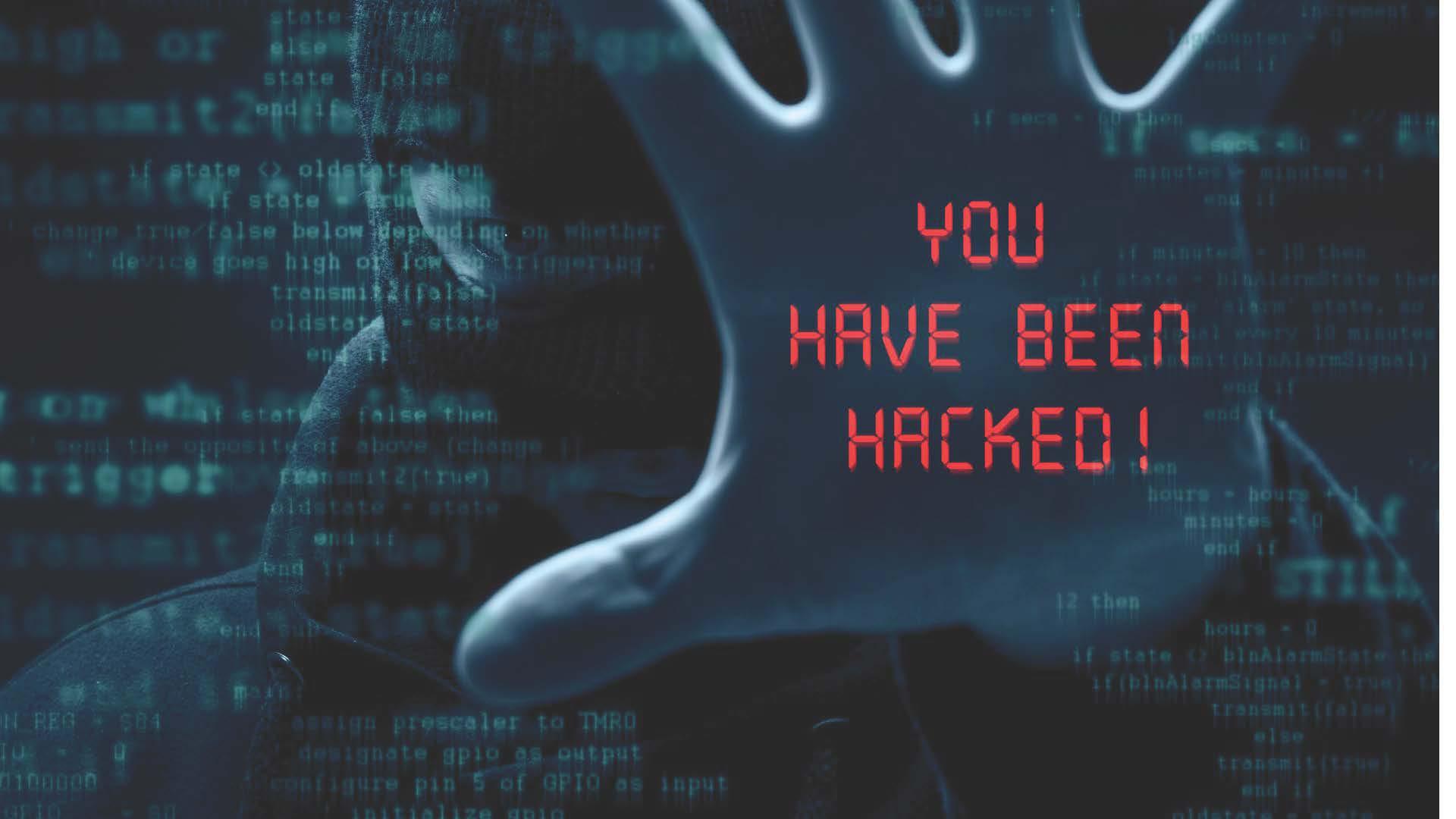 Hackerangriff Hand mit Schriftzug